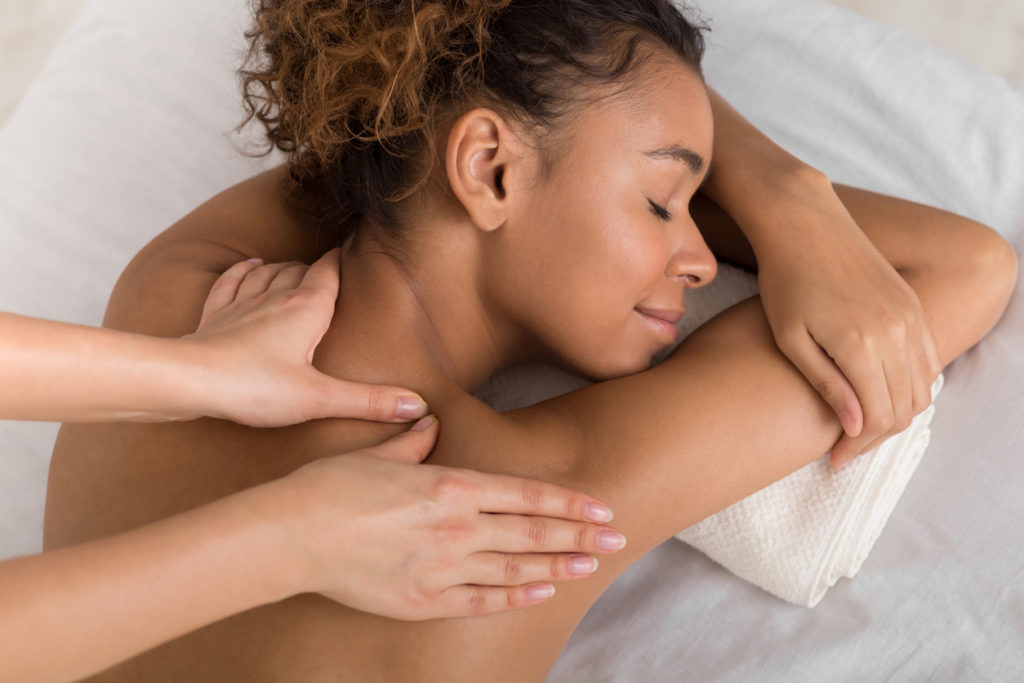 A woman receiving a deep tissue massage