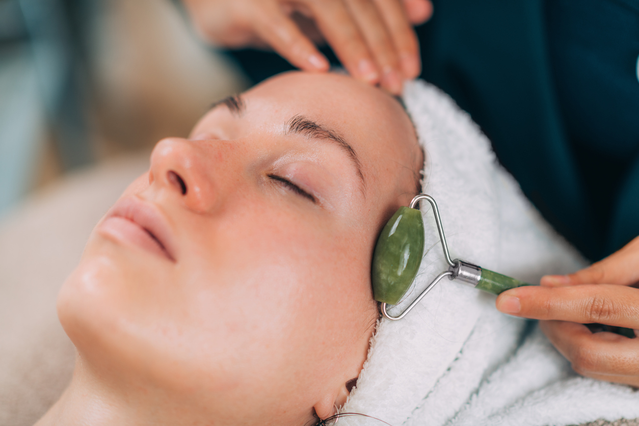 woman receiving gua sha facial