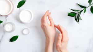 hands beside jars of CBD massage lotion